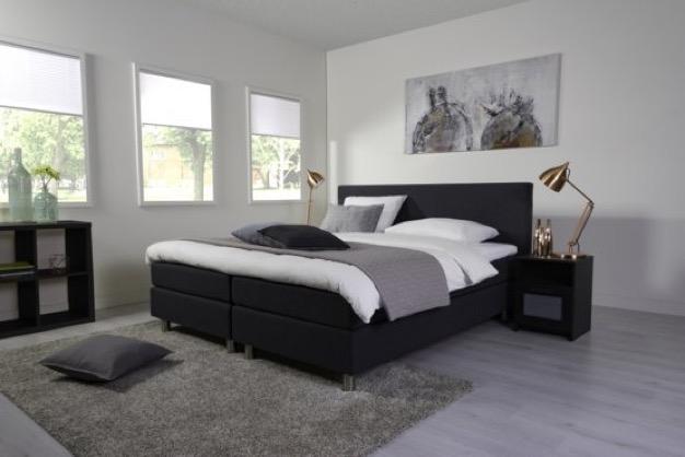 Een comfortabel bed met een unieke uitstraling